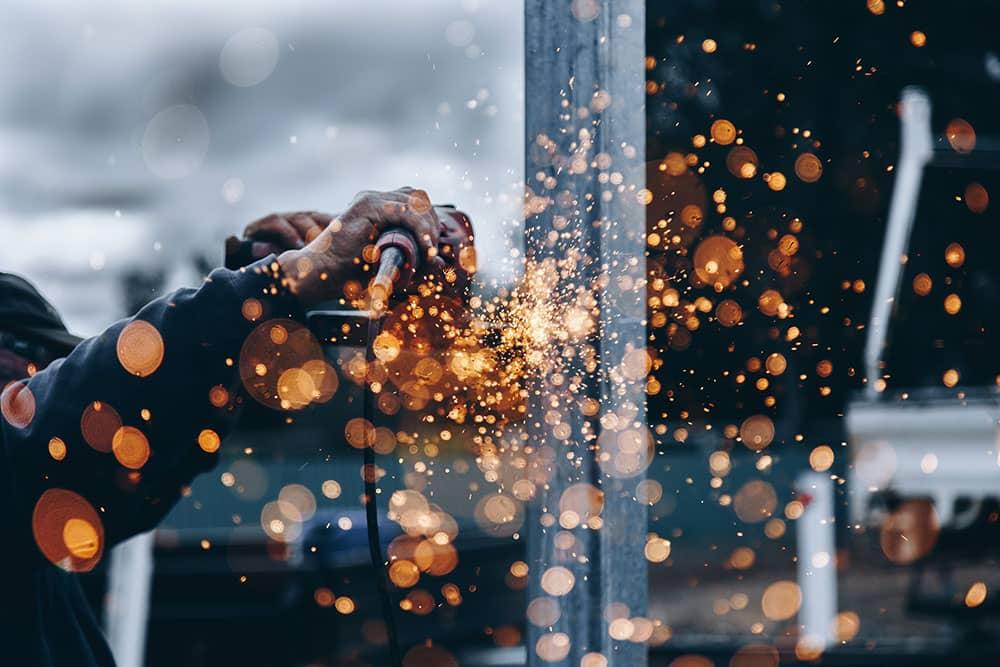 metal worker cutting steel